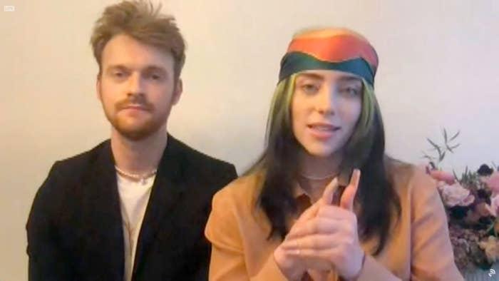 Finneas O'Connell and Billie Eilish accept an award at the 2021 Grammy Awards