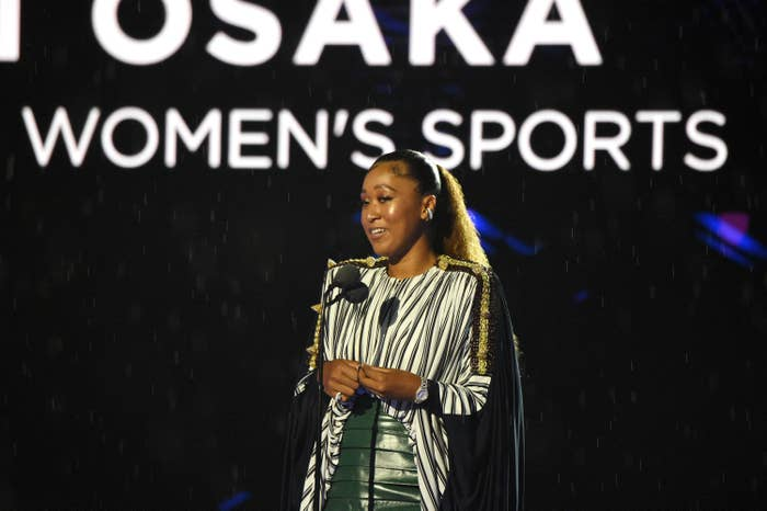 Naomi Osaka onstage and speaking into a microphone
