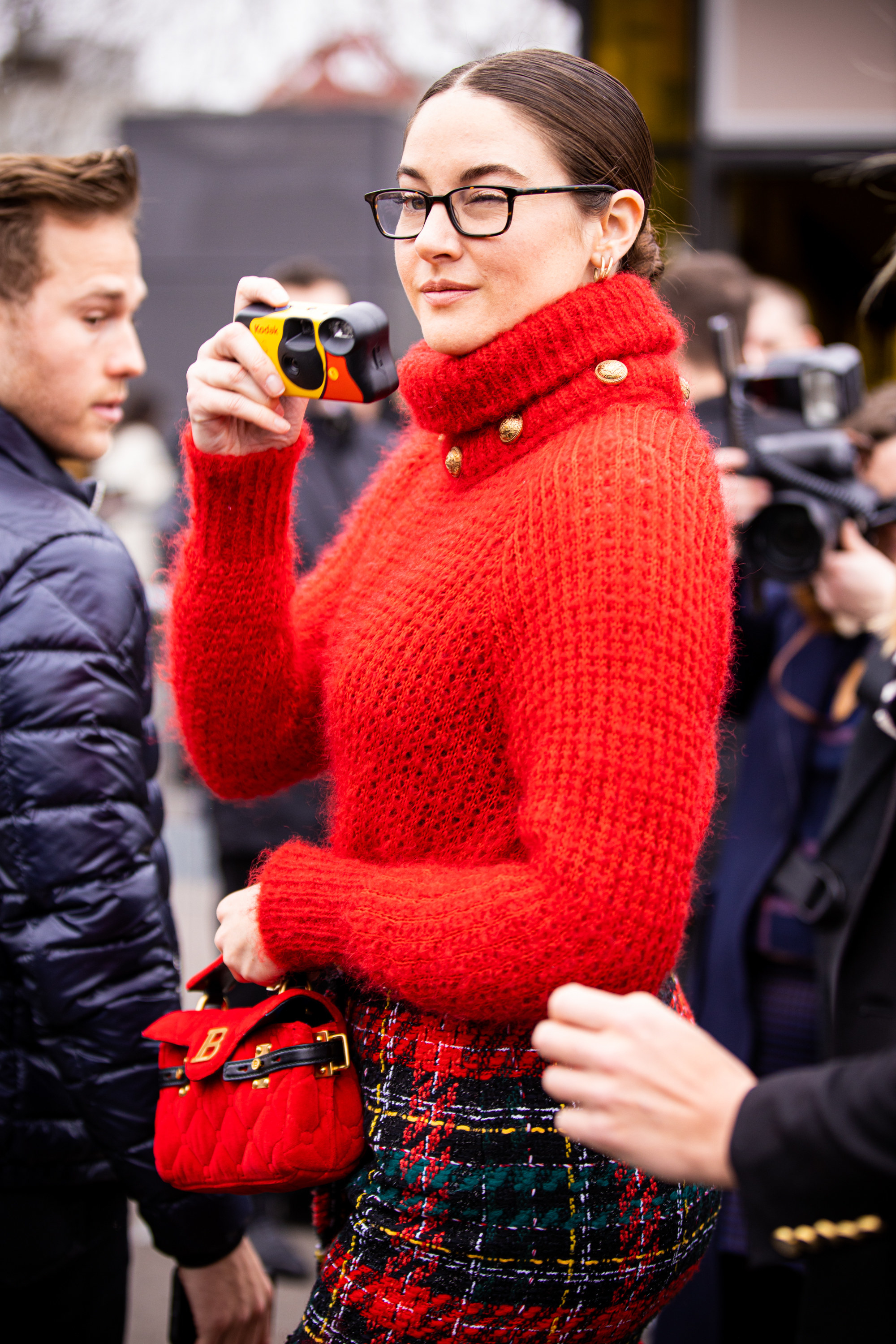 Shailene Woodley is photographed while taking a picture with a disposable camera in Paris, France