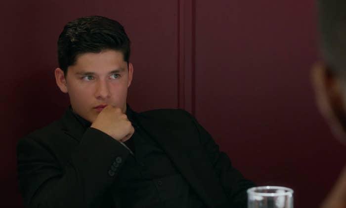 "Zig from ""Degrassi"" sitting at fancy restaurant thinking"