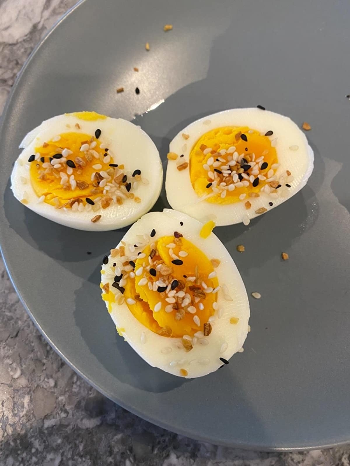 Reviewer's photo of three hard-boiled eggs with seasoning