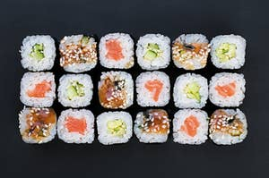 a couple different cut up sushi rolls