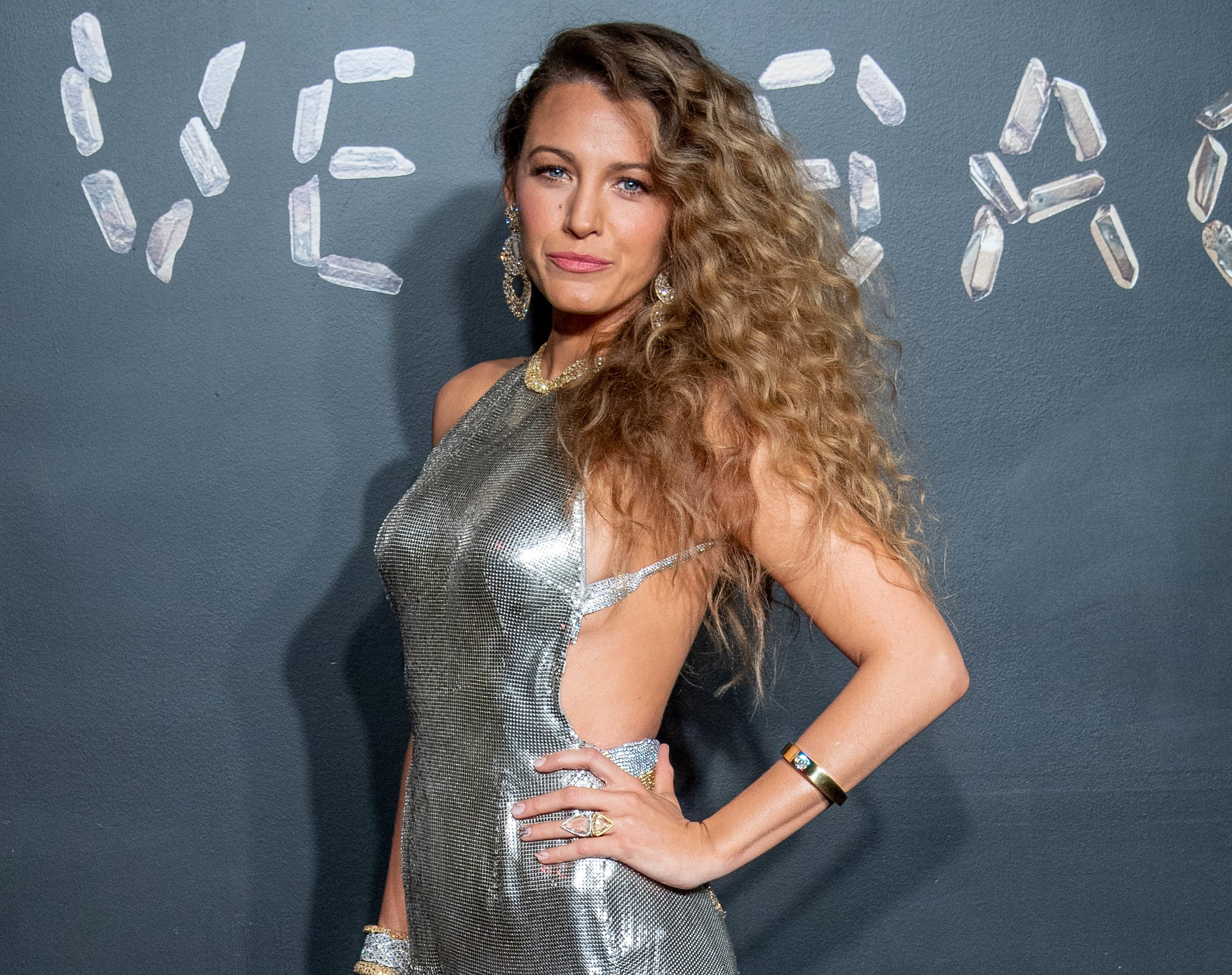 Blake wears a shimmering silver halter dress at an event