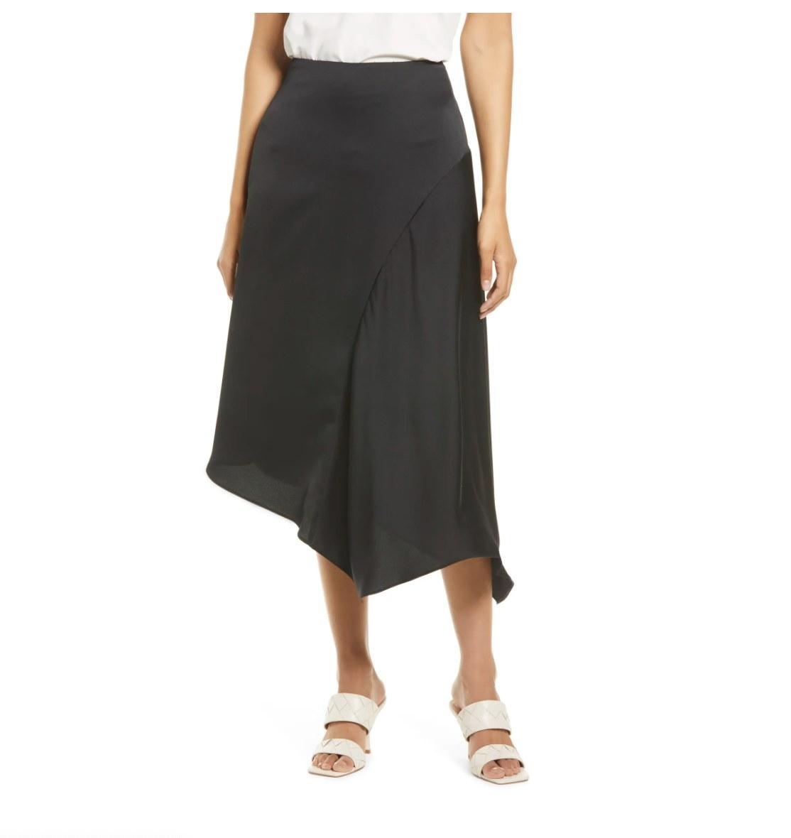 the asymmetrical satin skirt in black