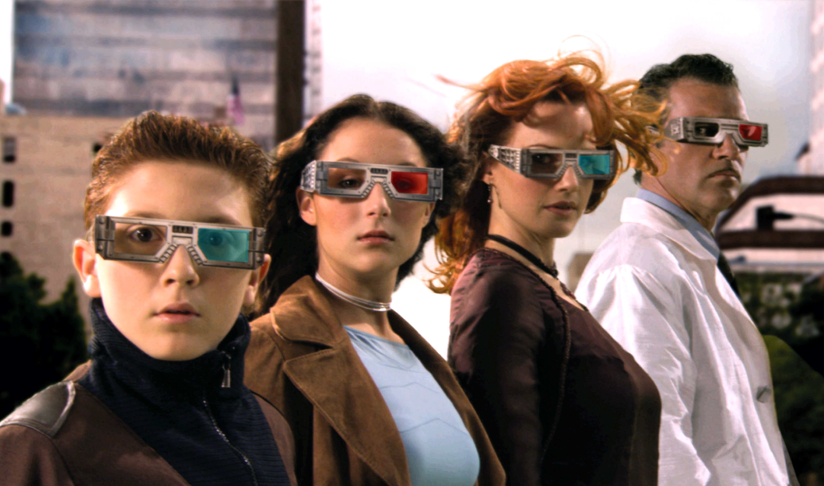 The Spy Kids family standing in line while wearing their high-tech spy glasses