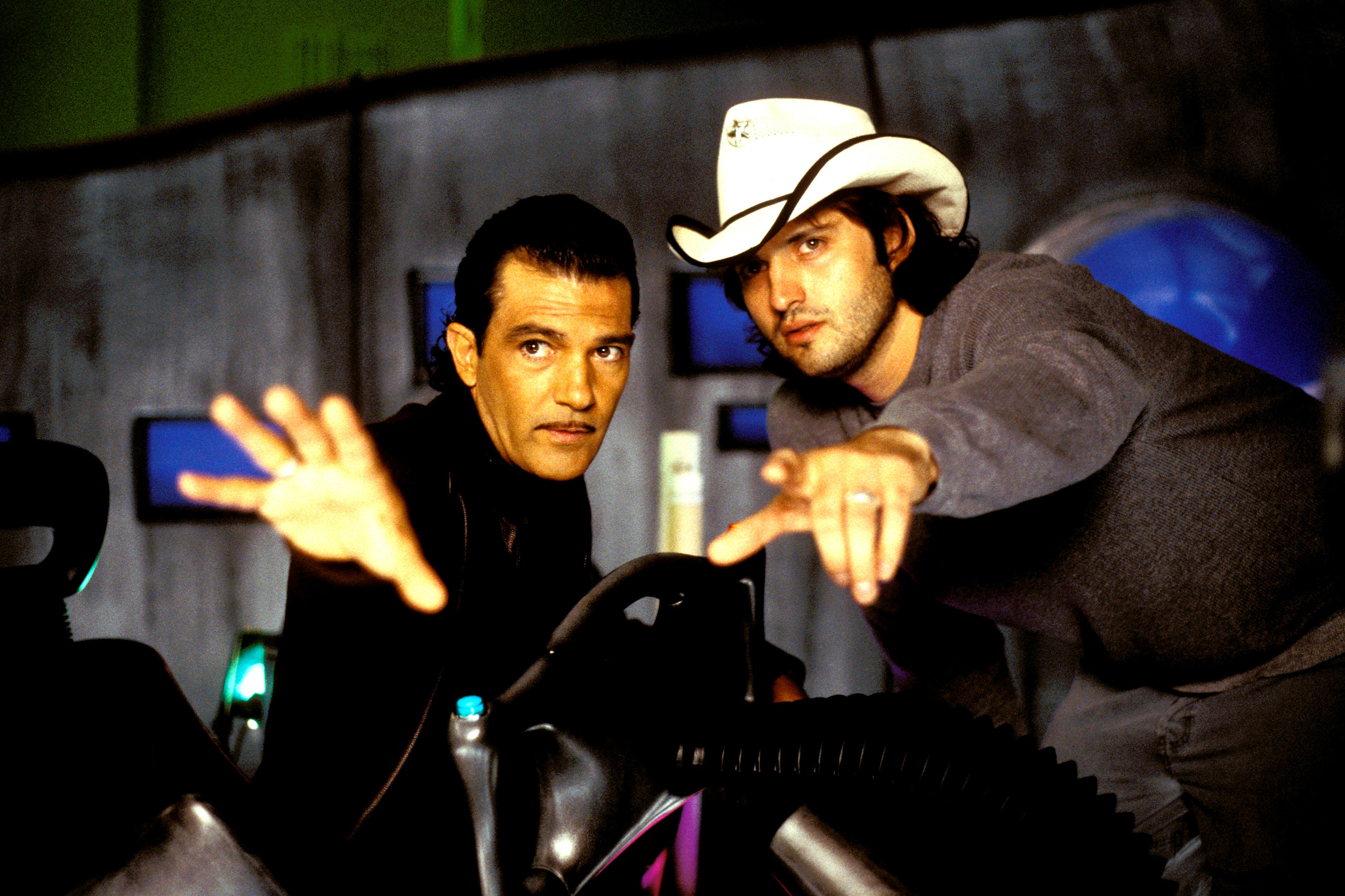 Antonio Banderas and Robert Rodriguez pointing at something off camera as they work out a scene