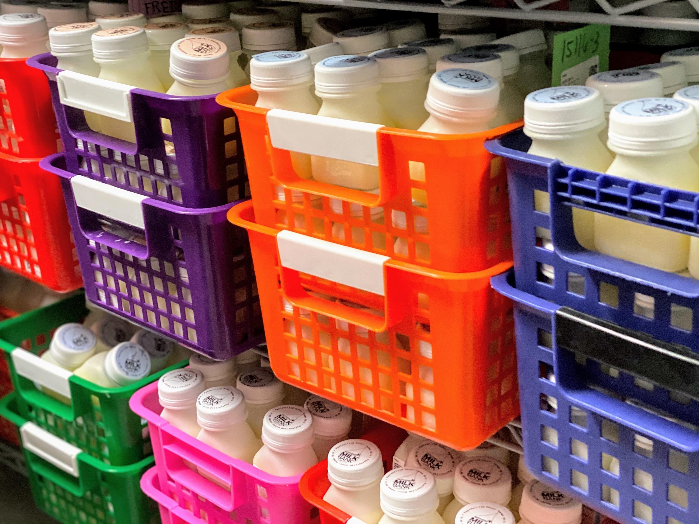 Colorful bins of bottled breast milk