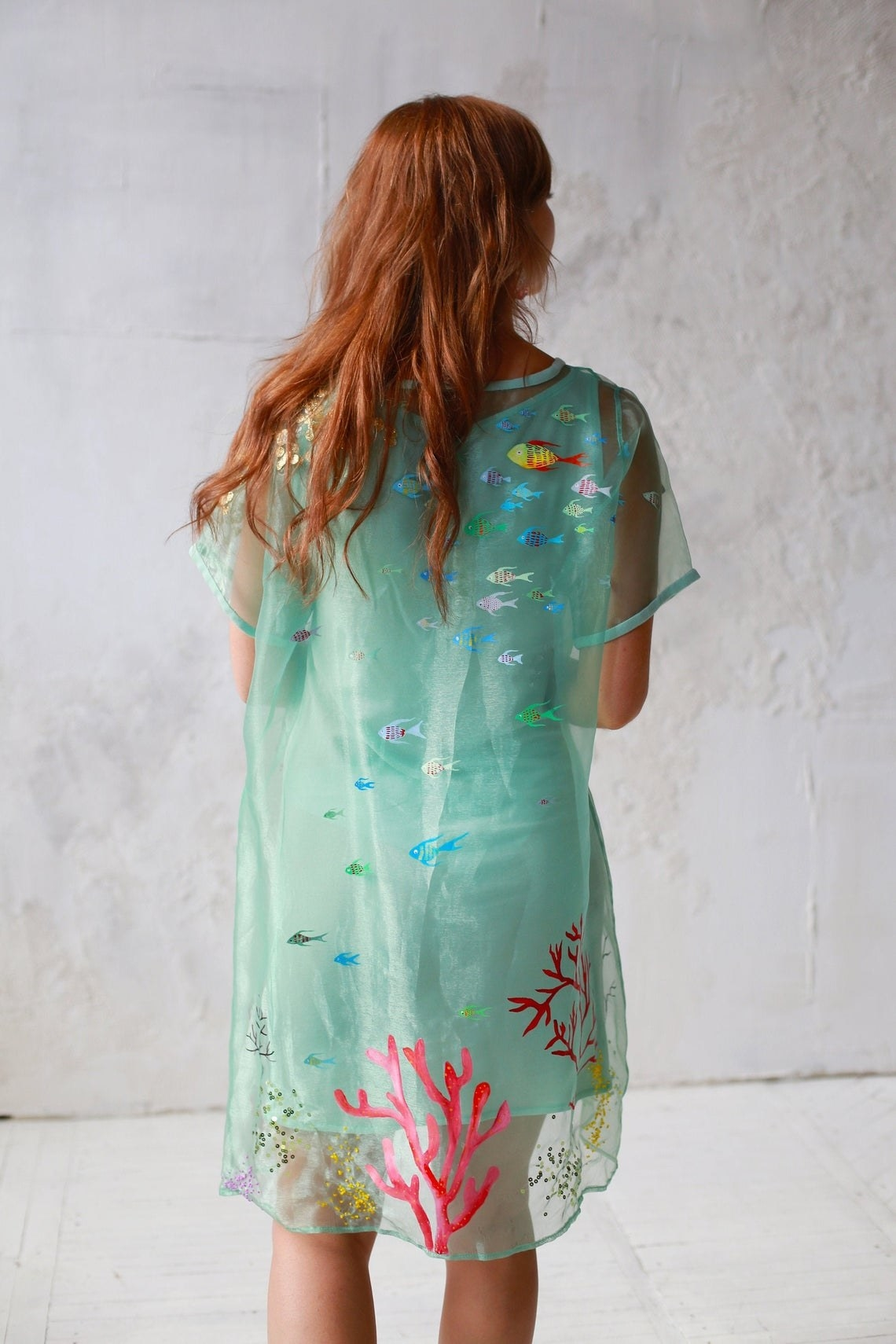 short sleeve sheer dress with embroidered and painted sea life over a blue slip