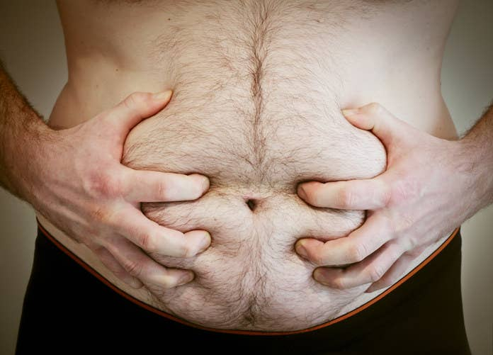 A man holding his stomach