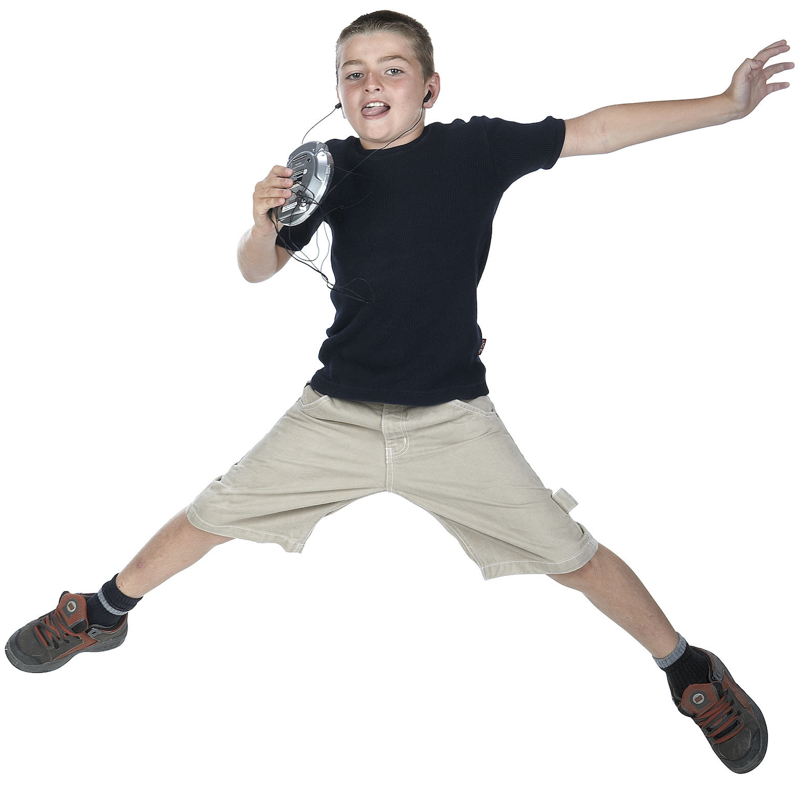 Stock image of kid jumping while listening to music on portable CD