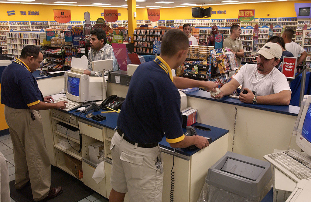 Cashiers helping customers at Blockbuster