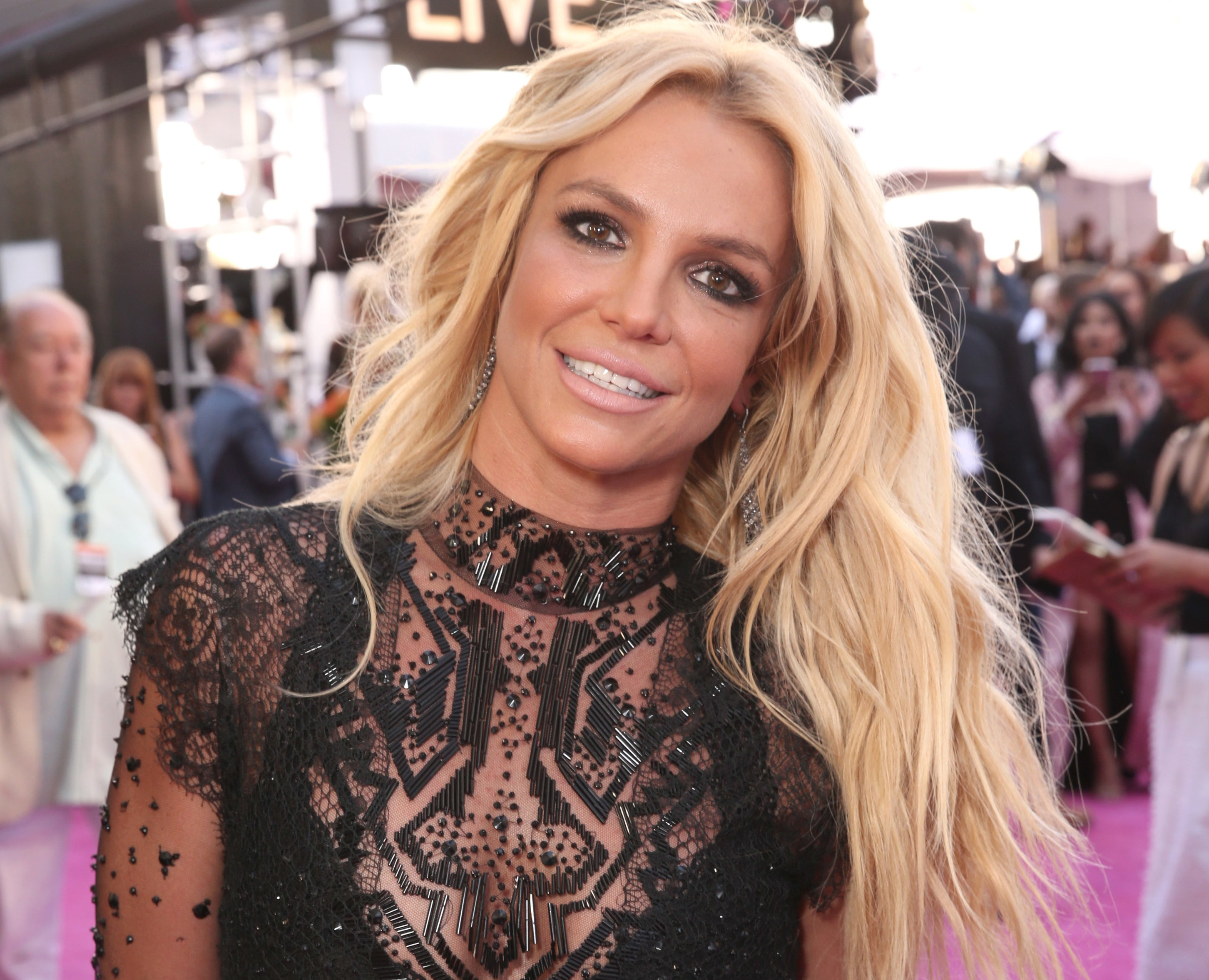Britney smiles while tossing her hair