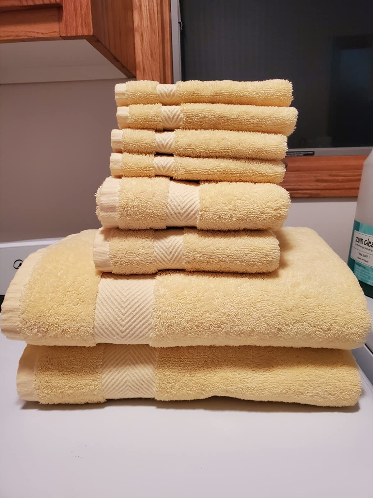 a reviewer photo of the bath set in yellow.