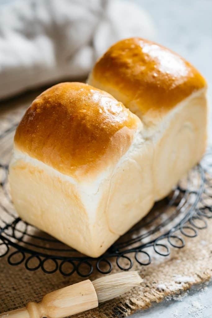 Shiny loaves of milk bread.