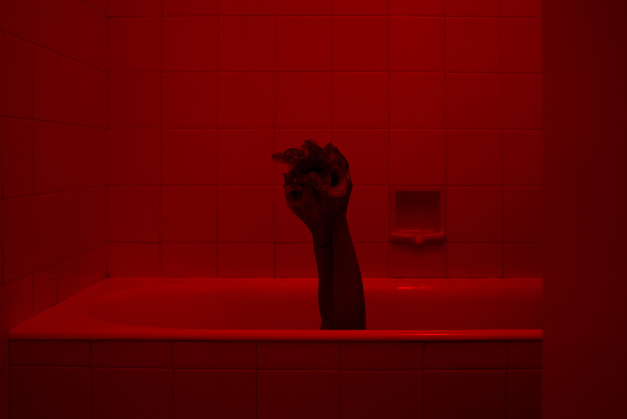 Scary hand sticking out of a bathtub