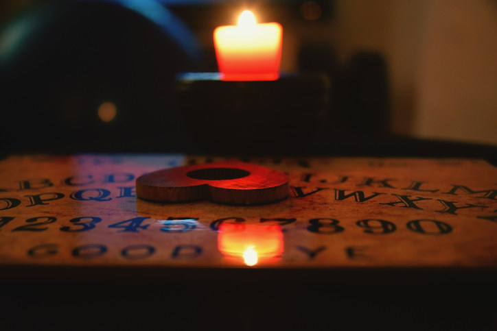 A candle and a Ouija board