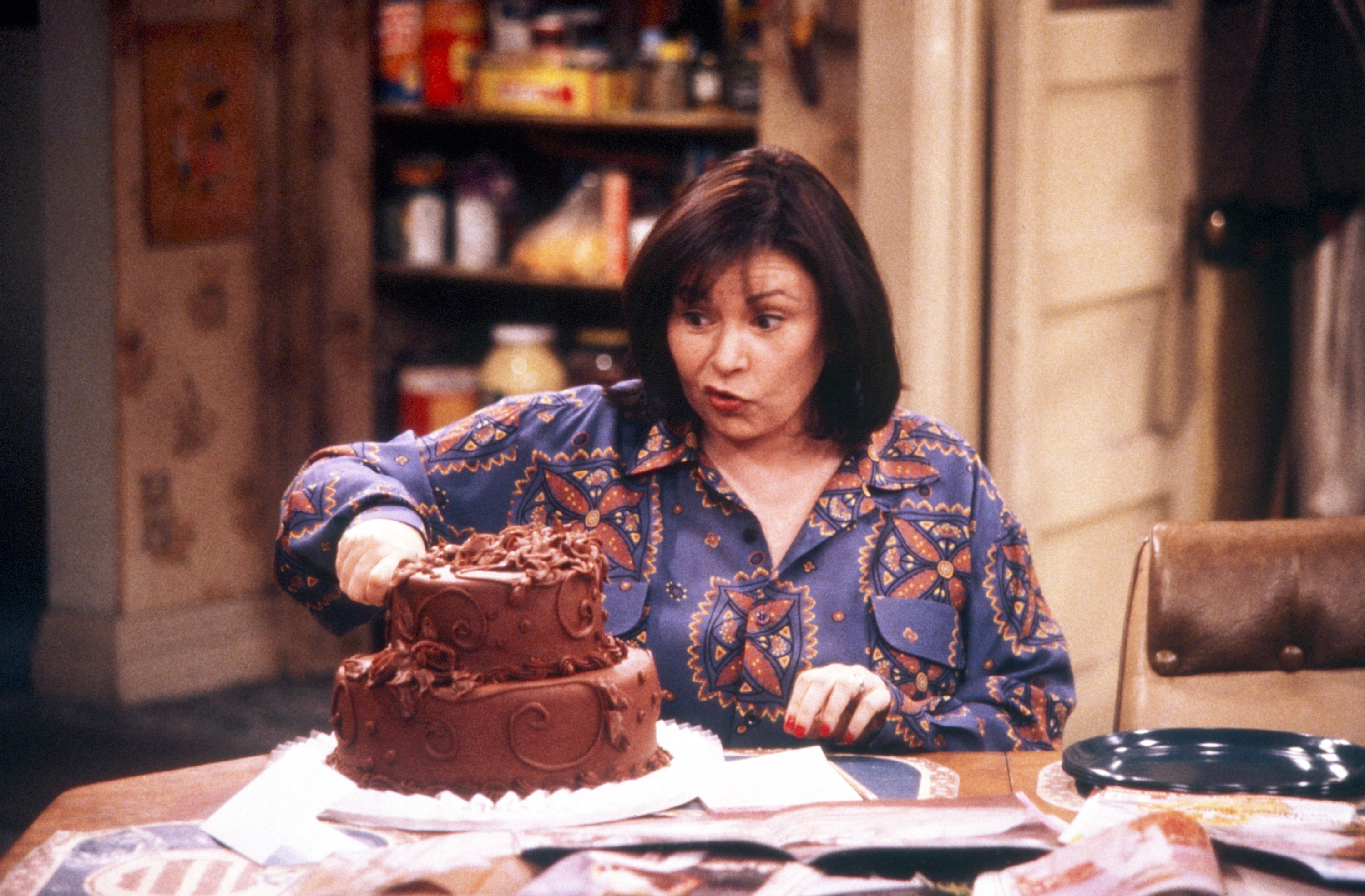 """Roseanne eating a chocolate cake in an episode of """"Roseanne"""""""
