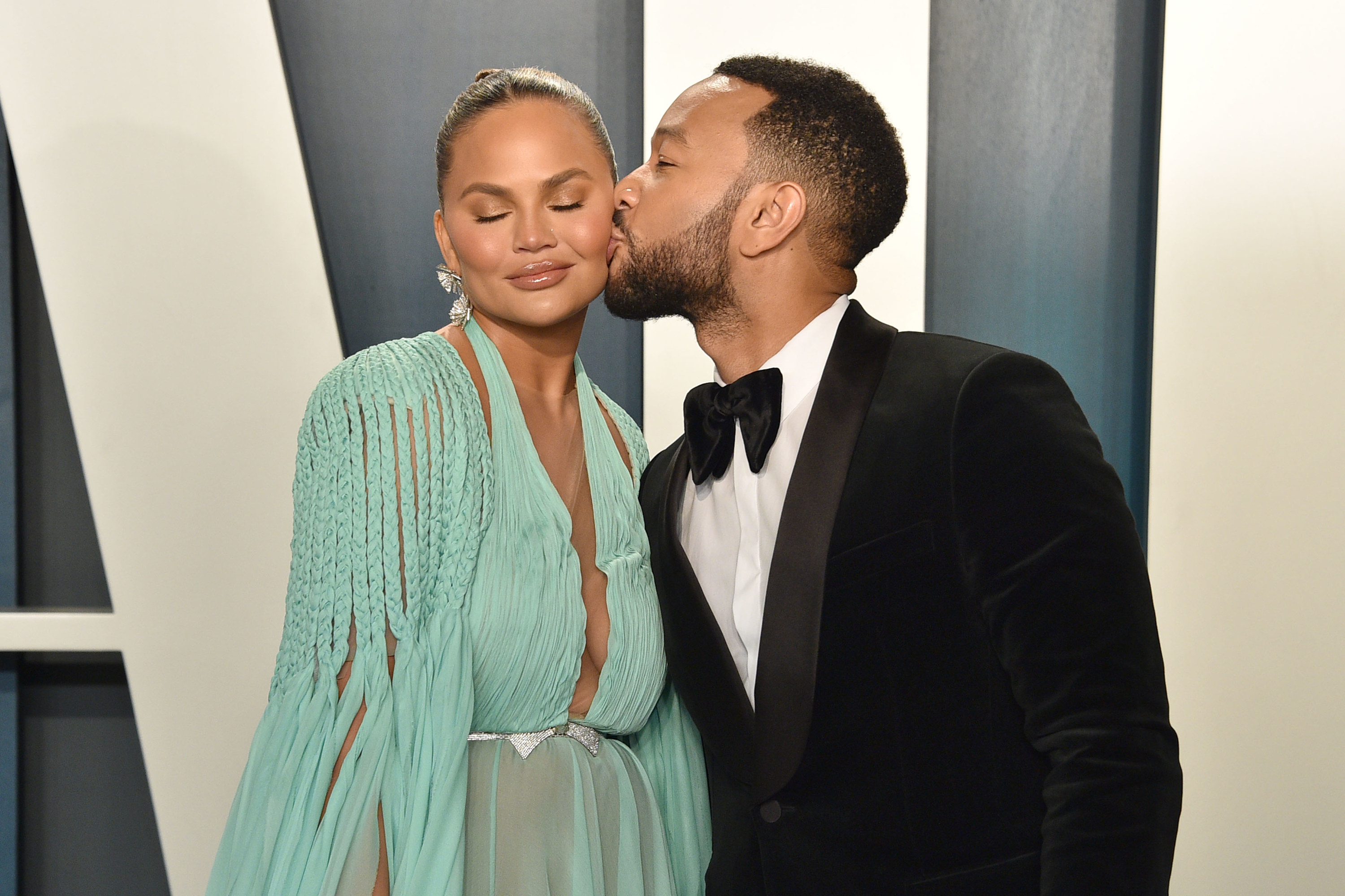 Chrissy Teigen and John Legend are pictured at the 2020 Vanity Fair Oscar Party
