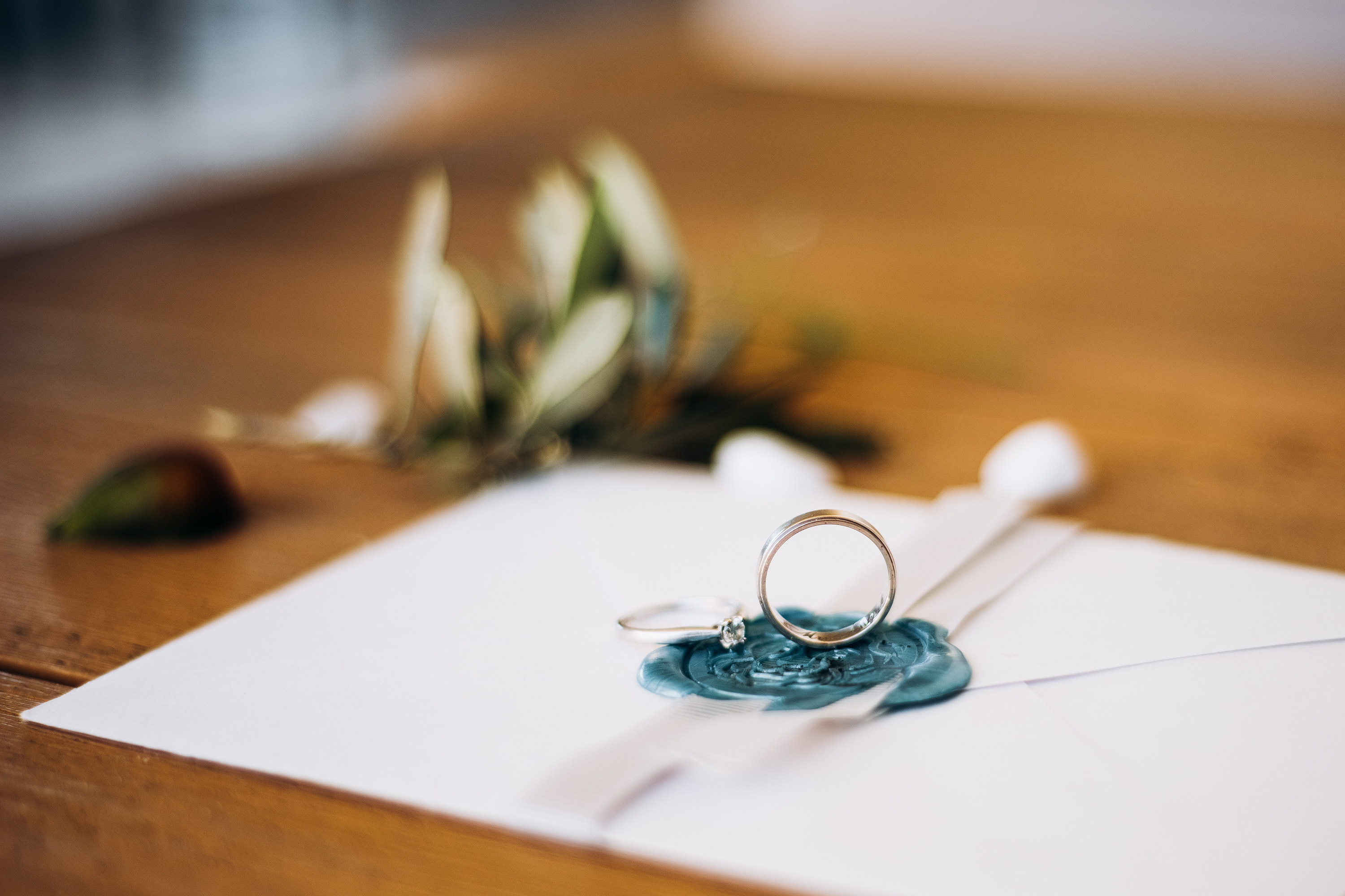 An invitation card with two rings laid on top