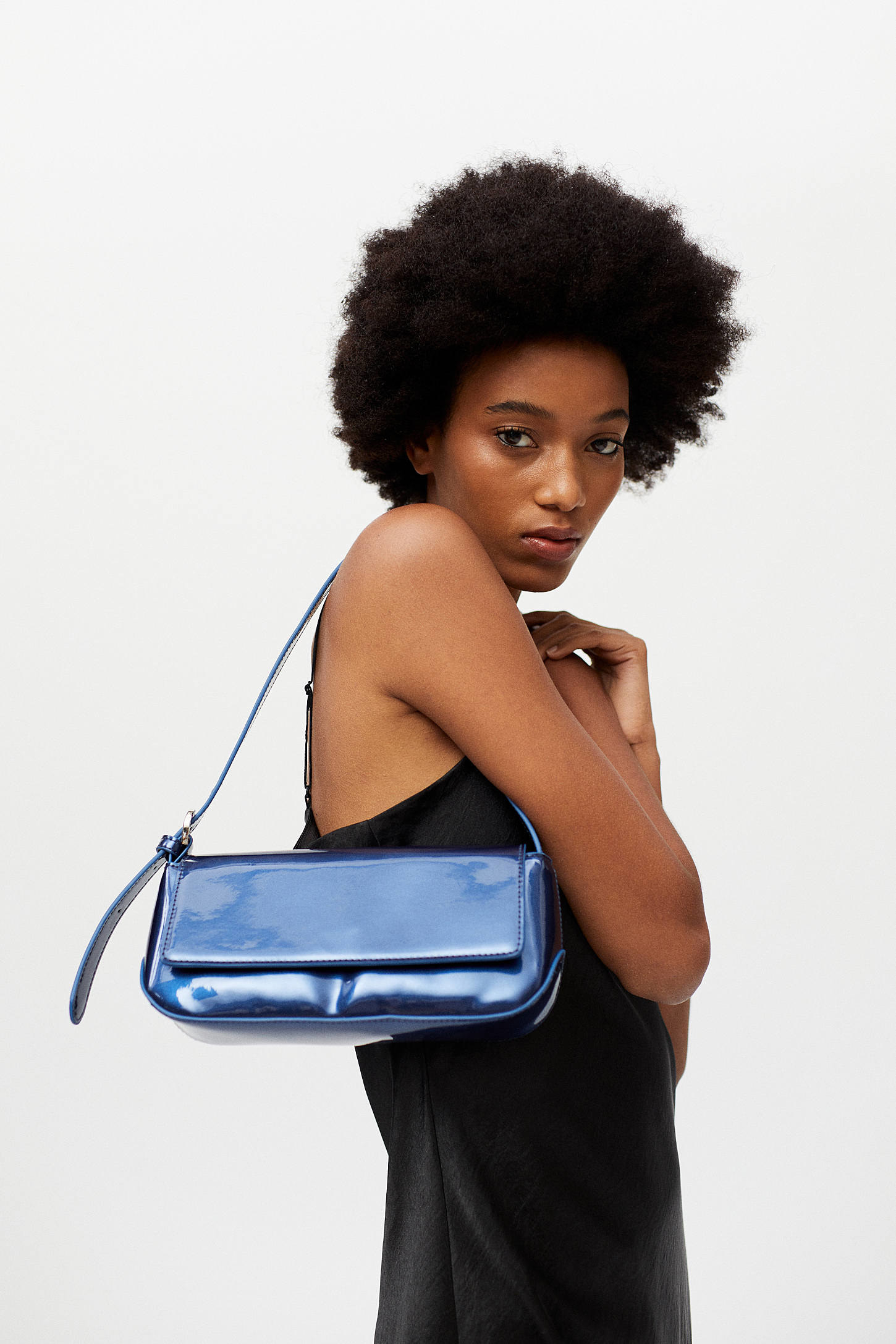 A person holding the shoulder bag