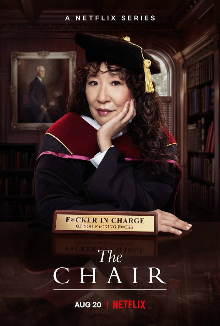 """A promo image for The Chair featuring Sandra wearing a professor's cap and gown with a plaque in front of her her that says """"Fucker in charge of you fucking fucks"""""""