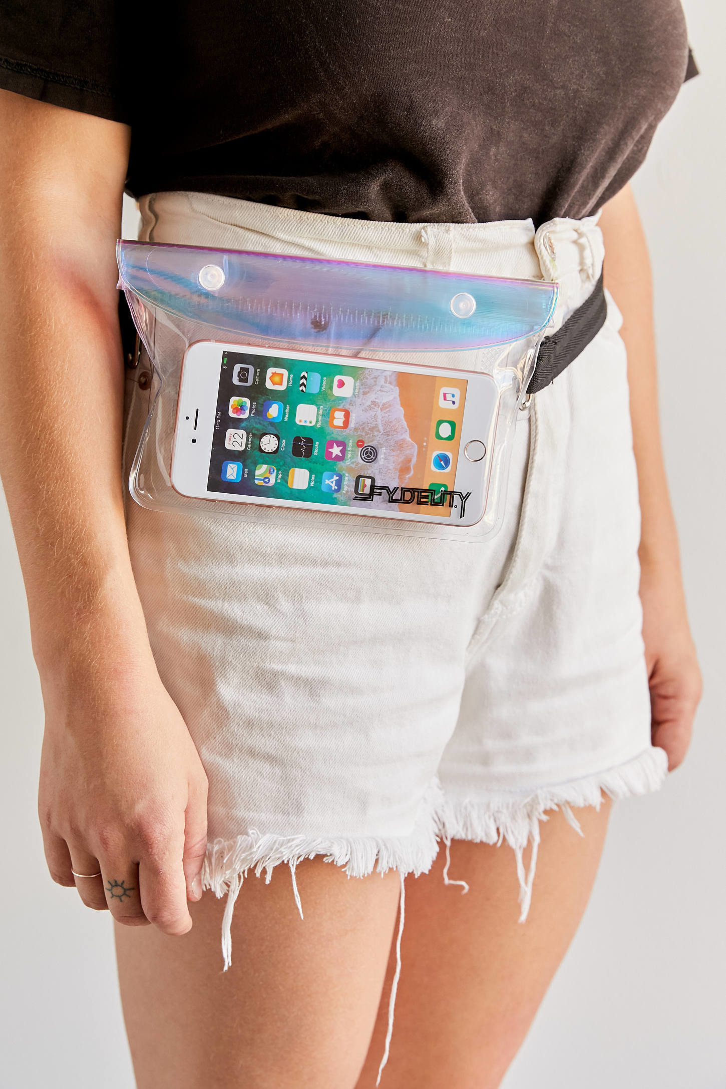 a person in shorts wearing the translucent fanny pack