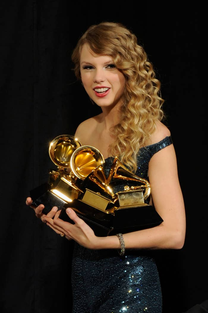 Taylor holding multiple Grammys
