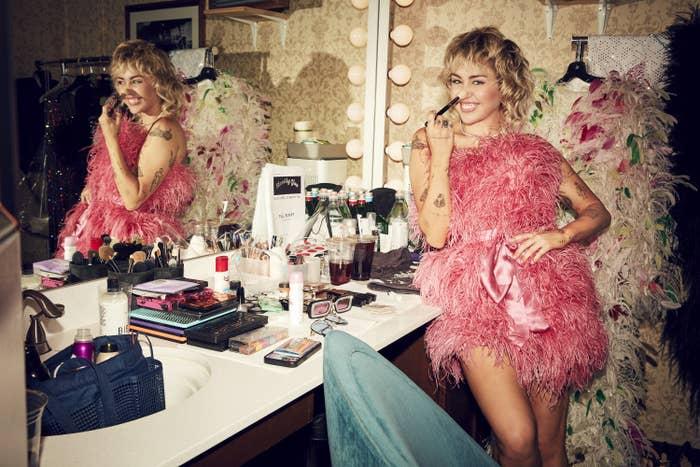 Miley Cyrus backstage getting ready
