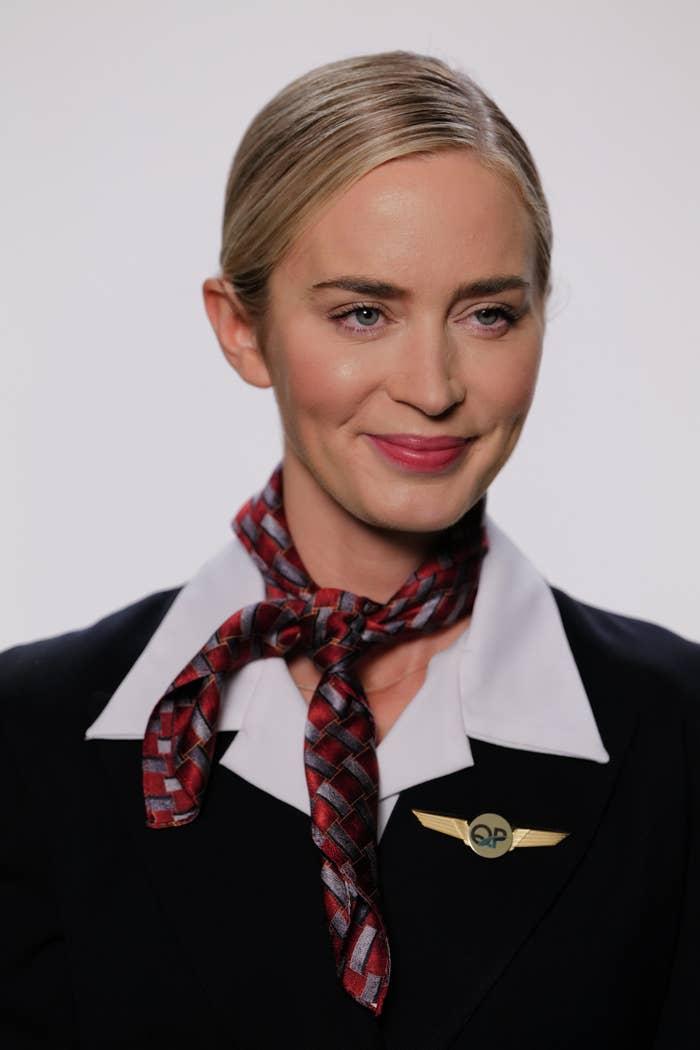 Emily Blunt wearing a scarf around her neck