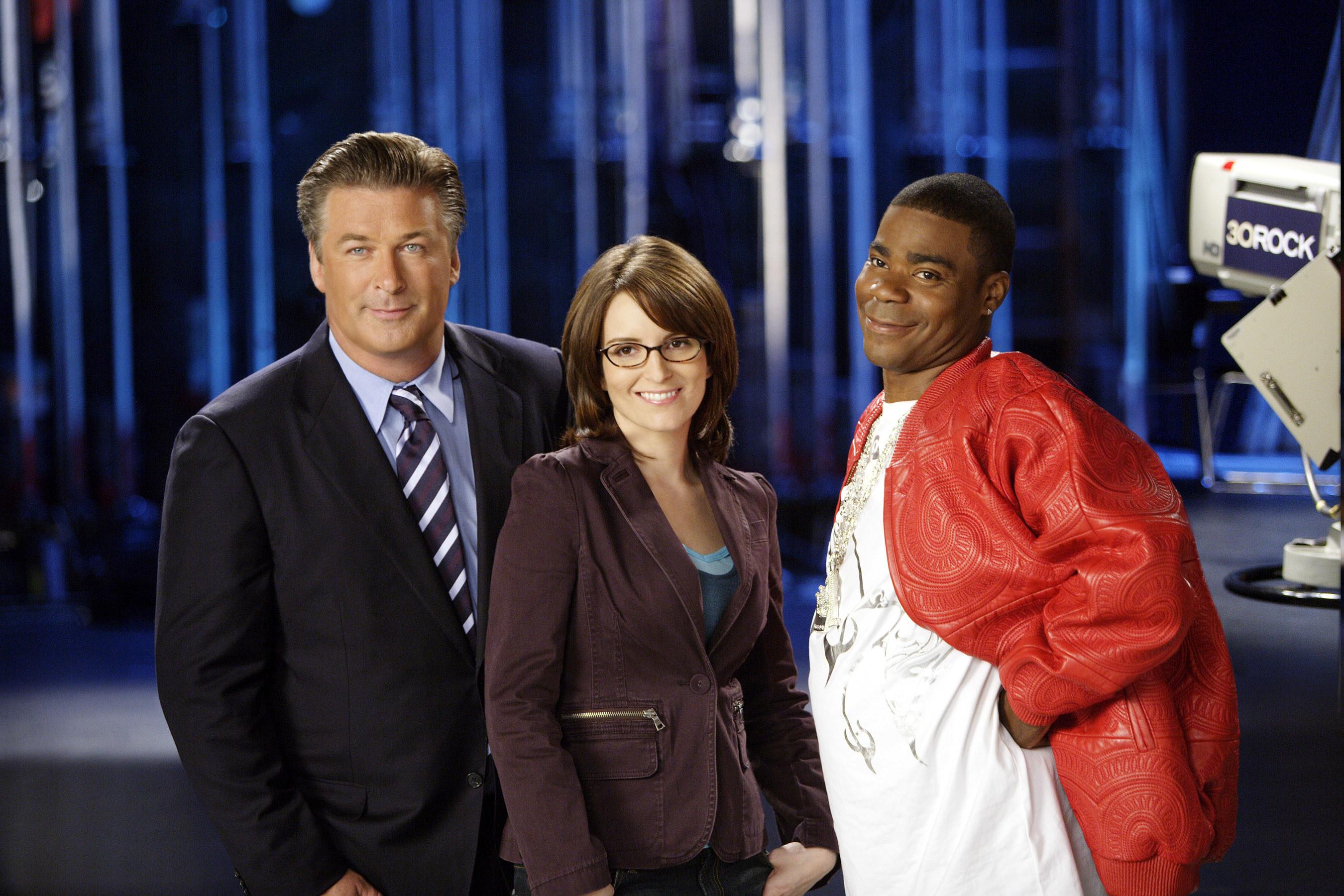 Alec Baldwin, Tina Fey, and Tracy Morgan posing for a promo photo