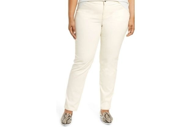 model wearing white pants with snakeskin shoes