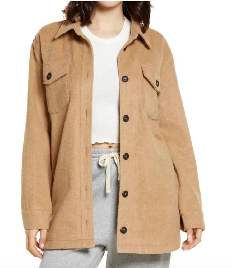Model wearing an oversized tan shirt jacket
