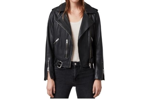 Model wearing black leather jacket, white tee and black jeans