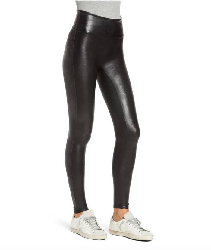 model wearing black fake leather leggings