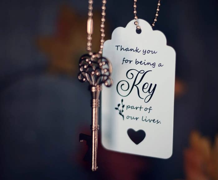 """Reviewer photo of the key and the tag that says """"Thank you for being a key part of our lives"""""""
