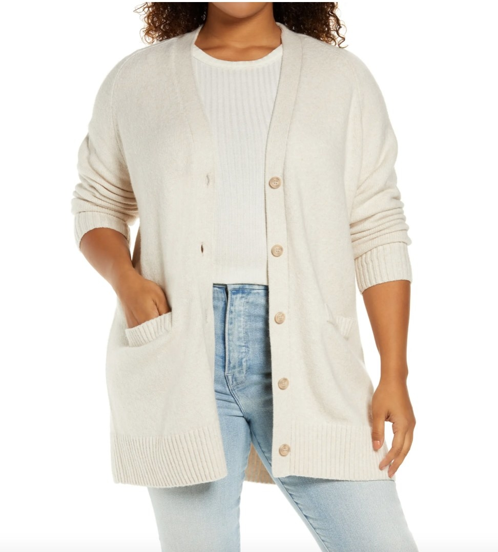 Model wearing white cardigan with white tee and jeans