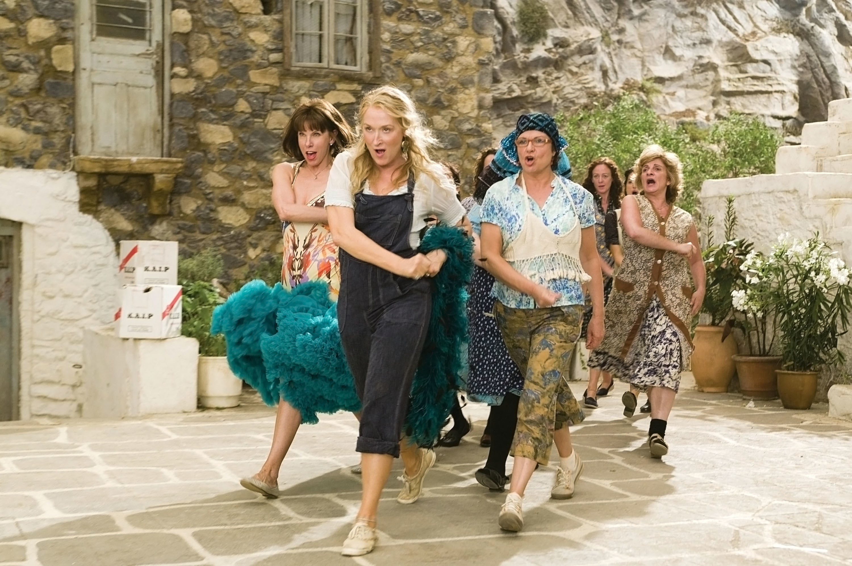 Christine Baranski, Meryl Streep, and Julie Walters walking.