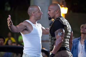 Vin Diesel and Dwayne Johnson in character during fast five