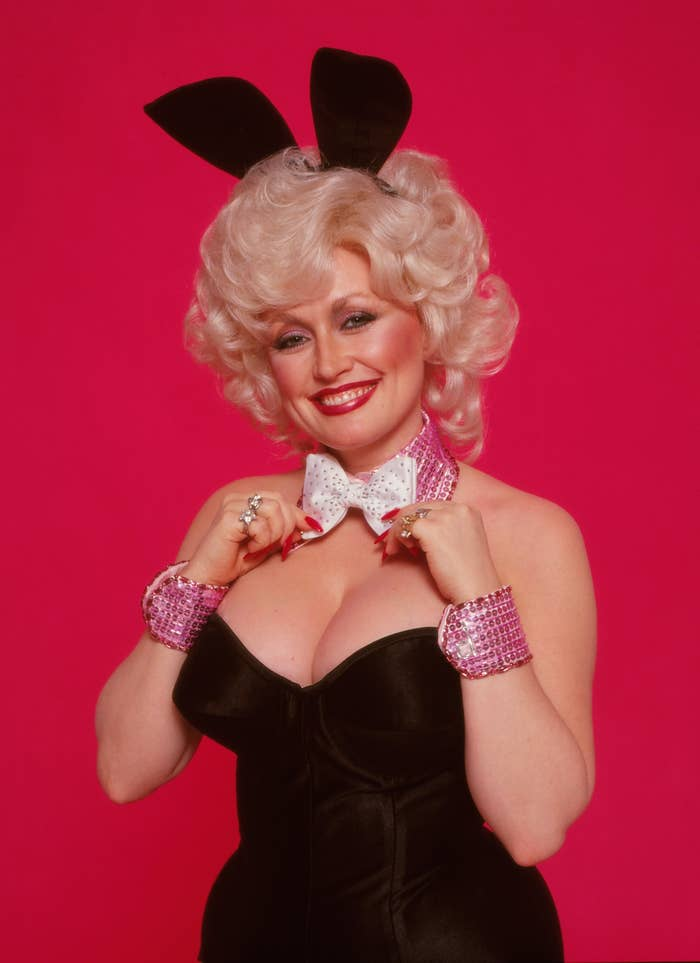 Dolly Parton poses as a Playboy bunny with bunny ears, a bow tie, and a corset