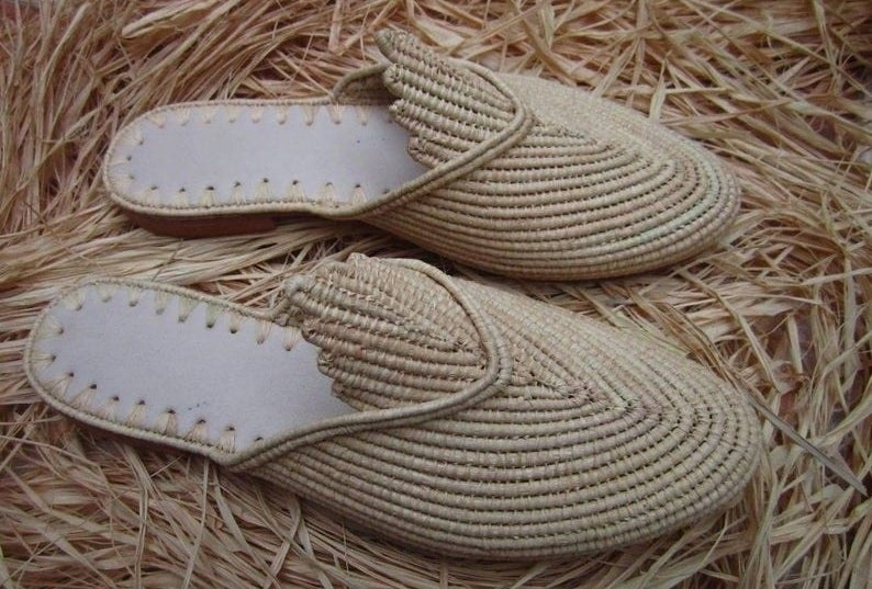 a pair of woven raffia round-toe mules