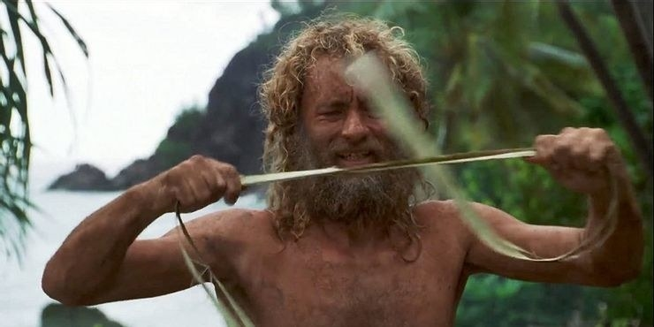 tom hanks in cast away pulling at a rope