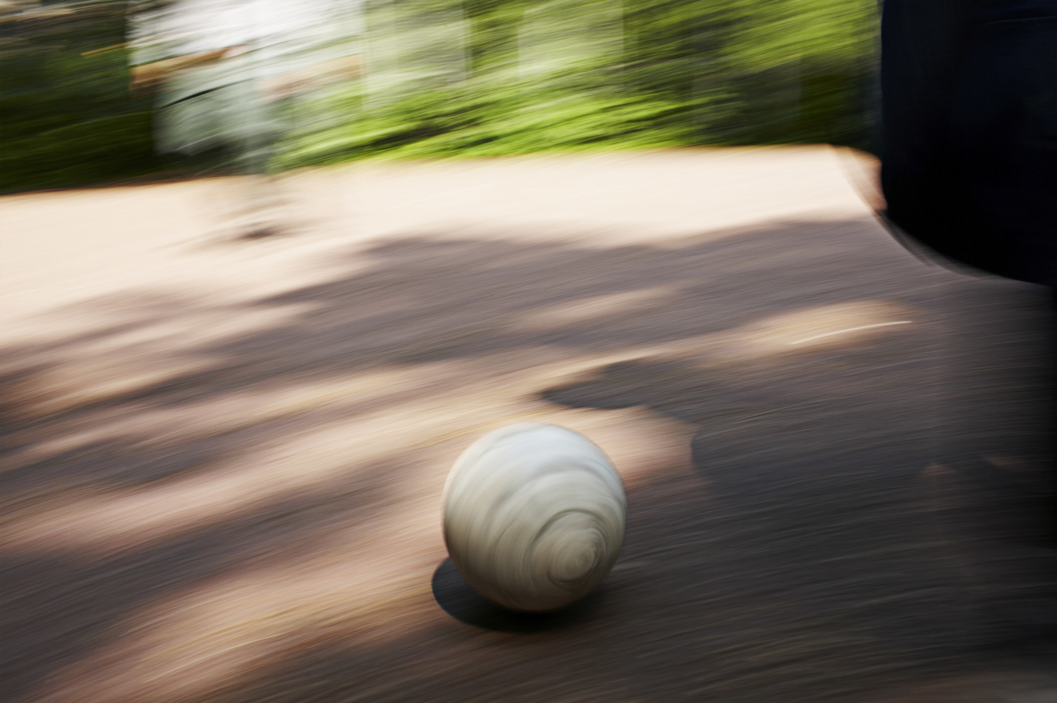 Ball rolling outdoors