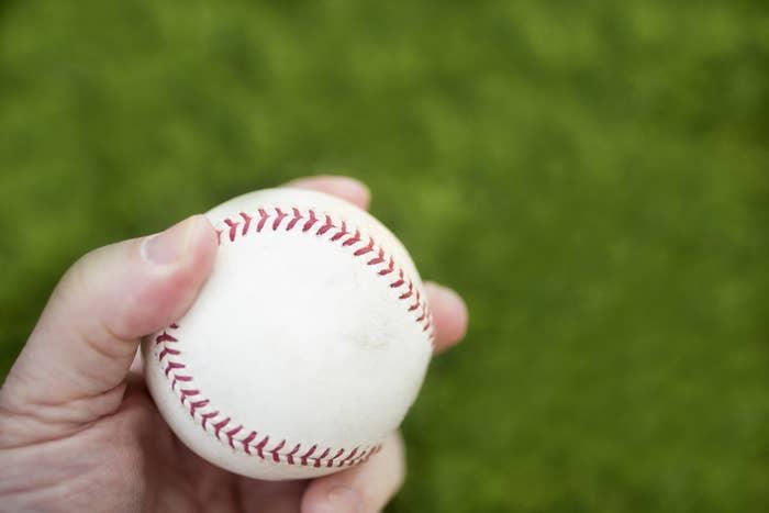 Left hand holding baseball