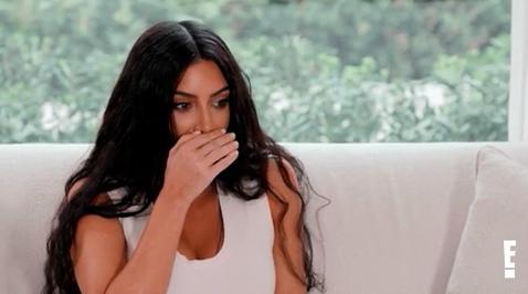 Kim Kardashian covering her mouth in shock