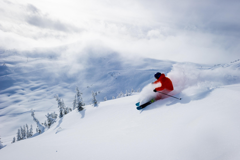 person skiing down mountain of snow