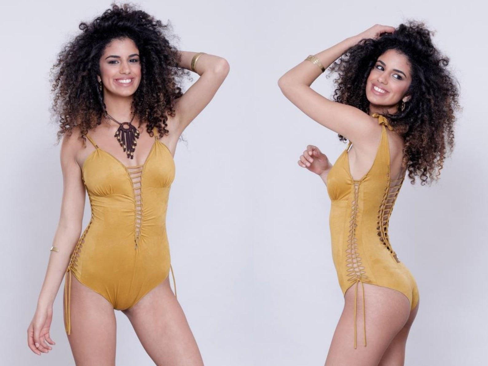 model wearing the mustard swimsuit