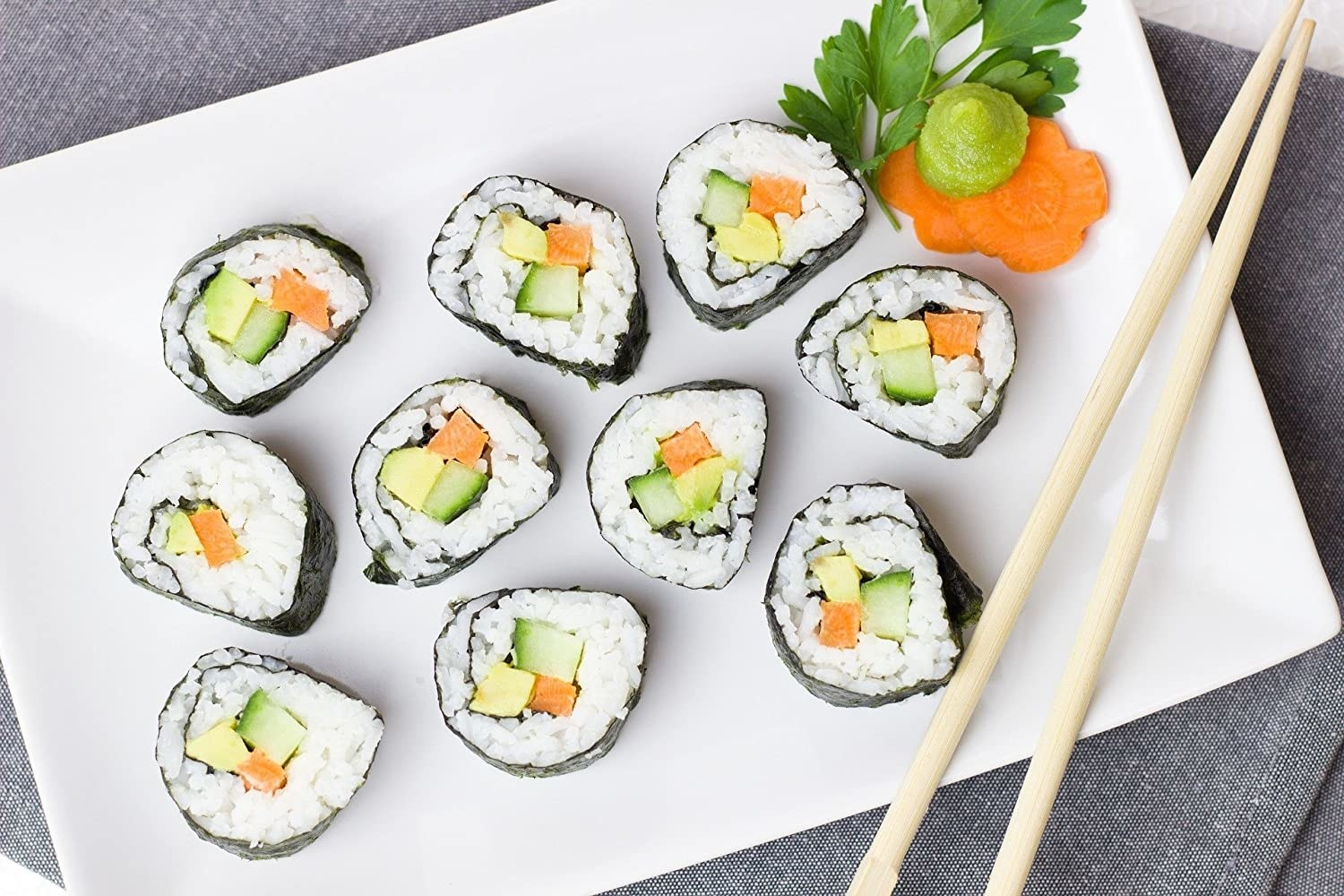 A plate of sushi with chopsticks