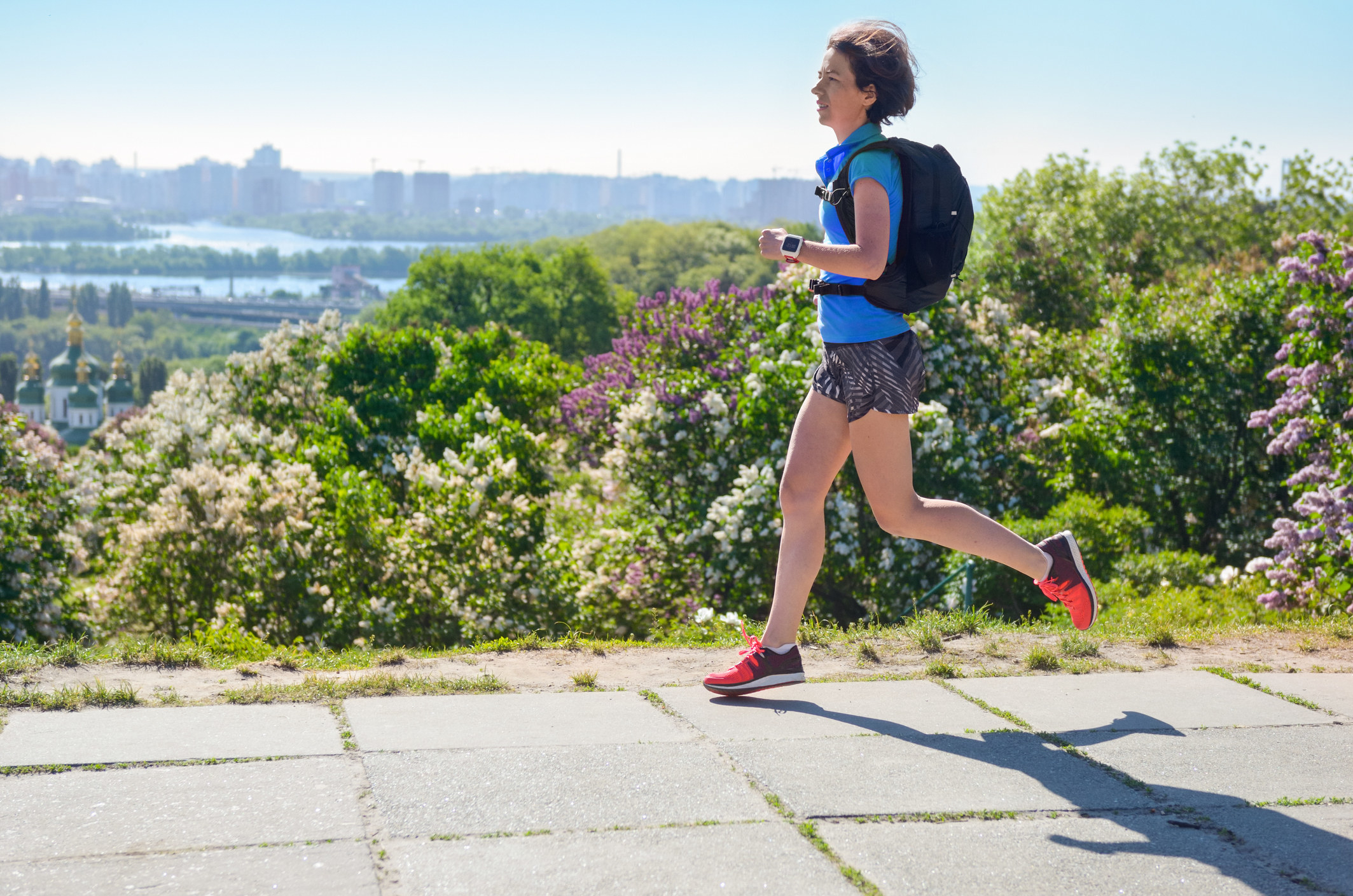 Woman running with backpack