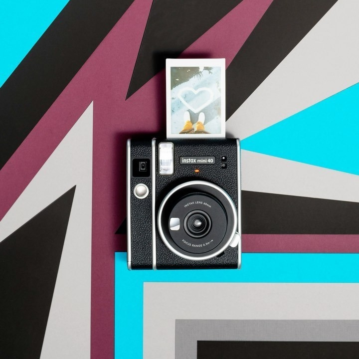 A retro camera on a floor