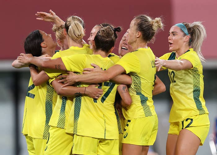 Sam Kerr of Australia is congratulated by team mates after she score her sides second goal during the Women's First Round Group G match during the Tokyo 2020 Olympic Games